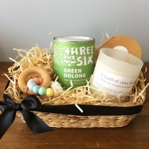 A hamper for parents who could use a little break. Includes a Bear and Finn candle, a Nature Bubz teething toy and a tin of Threeonesix tea.