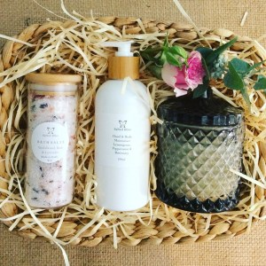 Relax and Enjoy Pamper Hamper contains a Salted Bliss Bath Salt, A Salted Bliss Hand and Body Cream and a Bear and Finn Scented Soy Candle packaged in a seagrass basket - A Touch of Class Florist