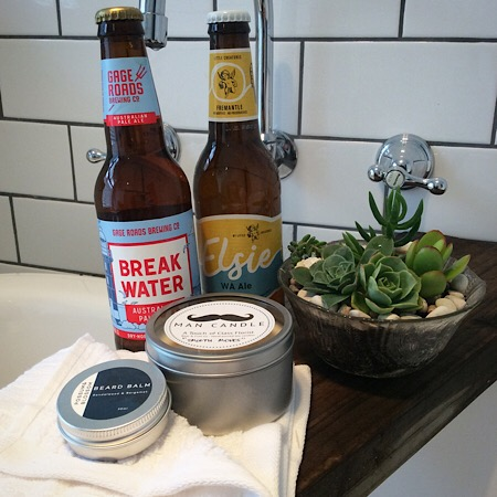 A gent's hamper that includes 2 bottles of craft beer, A Bear and Finn Man Candle and a beard balm from Possom and Blossum