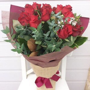 A Beautifully hand-tied red rose bouquet