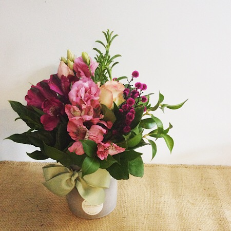 A short but cute ceramic vase arrangement in pink