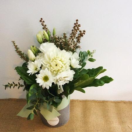 A short but cute ceramic vase arrangement in white