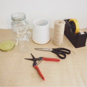 Selection of Floristry Tools For Making an Arrangement. Includes: Vase, cutters, scissors, twine and sticky tape.