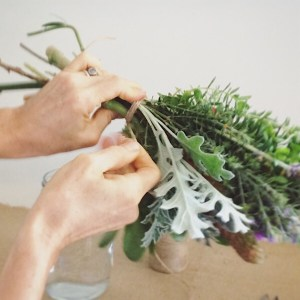 Tying off our posy style arrangement with twine.