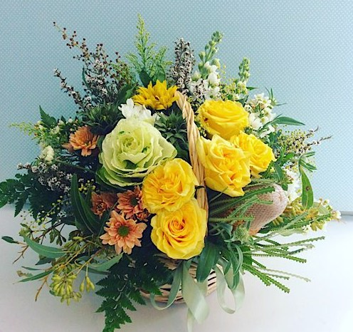 Radiance Flower Basket is a beautiful tradional basket of yellow and golden toned flowers - A Touch of Class Florist