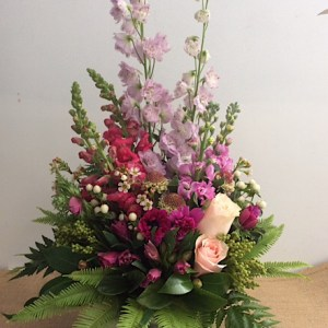 A Meadow In Pink Arrangement - A Touch of Class Florist