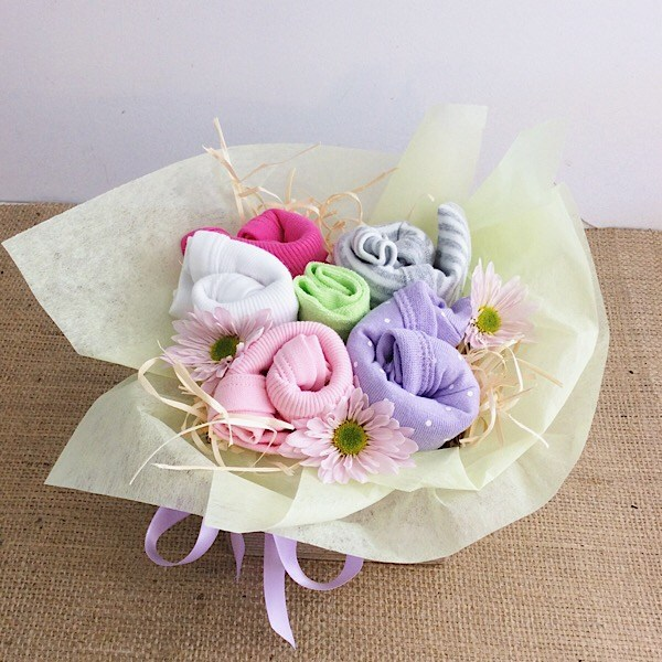 Baby Blooms in Pastel Pop, a goorgeous box of baby clothing items wrapped up like a bouquet of flowers - A Touch of Class Florist