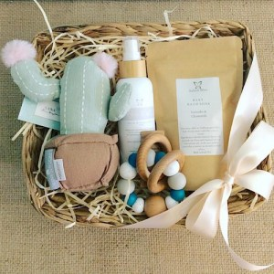 Nature Bubba Hamper contains a soft cactus baby rattle from Nana Huchy, 2 Salted bliss bath and body products and a Nature Bubz Teething ring - A Touch of Class Florist Perth