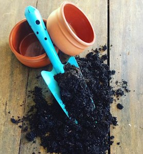 Potted Plant Gifts and Care, image of soil, pots and trowel - A Touch of Class Florist Perth