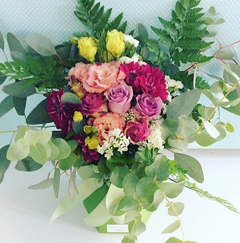 Berri-licious Arrangement in a card vase. Is created with beautiful pink blooms with a touch of lilac or purple - A Touch of Class Florist Perth