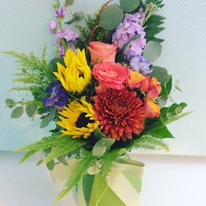 Bright Posy Box Arrangement is a mix of seasonal bright blooms arranged into a card vase - A touch of Class Florist Perth