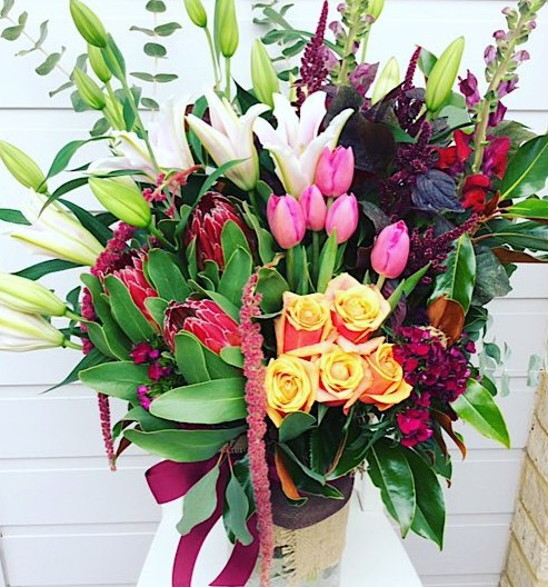 Raspberry Ripple Vase Arrangment is a large arrangement of grouped blooms in pink, purple and peachy tones - A Touch of Class Florist Perth