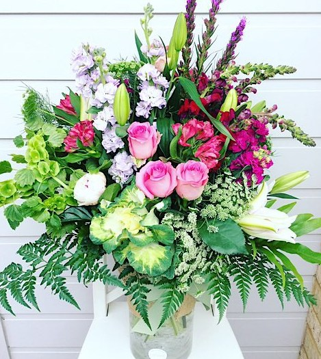 Lush Garden Vase Arrangement is a tall glass vase arrangement full of beautiful garden inspired blooms and foliage - A Touch of Class Florist Perth