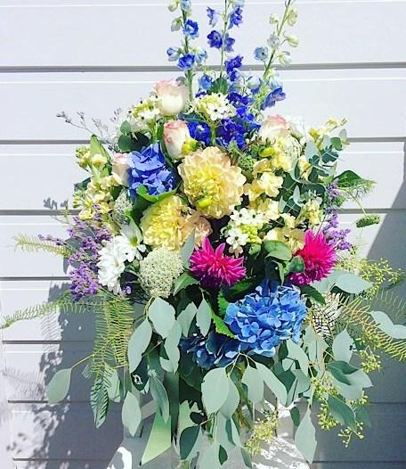 Lush Garden Vase Arrangement is a tall glass vase arrangement full of garden inspired blooms and foliage - A Touch of Class Florist Perth