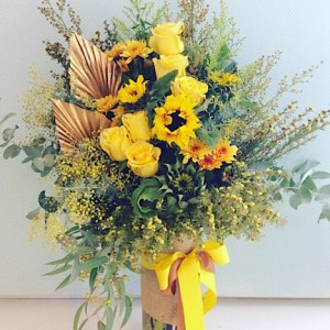 Sunshine Vase Arrangement Deluxe Value contains more beautiful yellow blooms in a tall glass vase - A Touch of Class Florist Perth