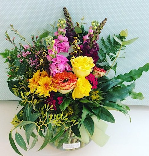 Hazy Daze Fishbowl Arrangement contains bright beautiful blooms in pinks and yellows - A Touch of Class Florist Perth
