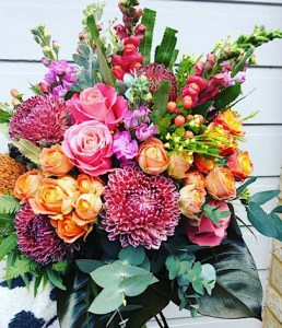 Sunset Luxury Posy Bouquet is a compact hand-tied bouquet full of sunset toned blooms - A Touch of Class Florist Perth