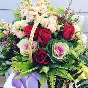 Cottage Flower Basket is a traditional basket arrangement in pink, white and red toned flowers - A Touch of Class Florist
