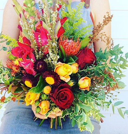 Rustic Posy Hand-tied Bouquet is a short but full posy of reds, oranges, bugundy and a hint of white blooms - A Touch of Class Florist