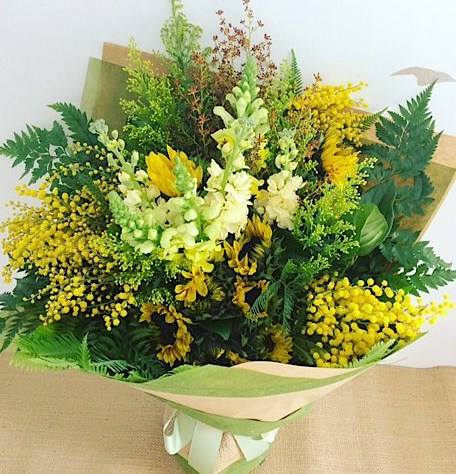 Florist Choice Yellow Hand-tied Bouquet is a joyful bouquet of seasonal yellow blooms - A Touch of Class Florist Perth