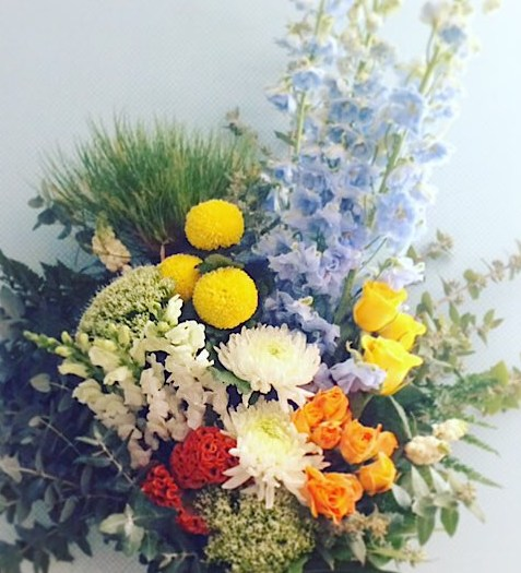 It's a Boy Hand-tied Bouquet uses a mix of seasonal blooms in yellows, blues, greens, white and purples - A Touch of Class Florist Perth