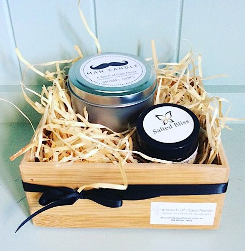 The Recovery Hamper For Him includes a scented candle from bear and finn as well as amagnesium balm from Salted Bliss, gift wrapped in a bamboo tray - A Touch of Class Florist Perth