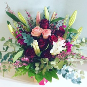 Pink Ladies Flower Arrangment is a feminine box arrangement including roses and lilies as well as other seasonal blooms - A Touch of Class Florist Perth
