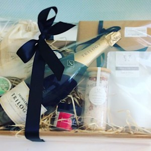 Pamper Hamper includes a selection of body and bath products from local Perth companies Salted Bliss and Possum and Blossom, as well as a Bear and Finn scented candle, a box of chocolates and a bottle of sparkling wine - A touch of Class Florist