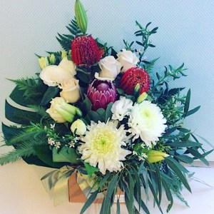 Dasher Box Arrangement is an arrangement filled with seasonal red and white blooms. We compliment theses with greenery to give some texture and flow - A Touch of Class florist Perth