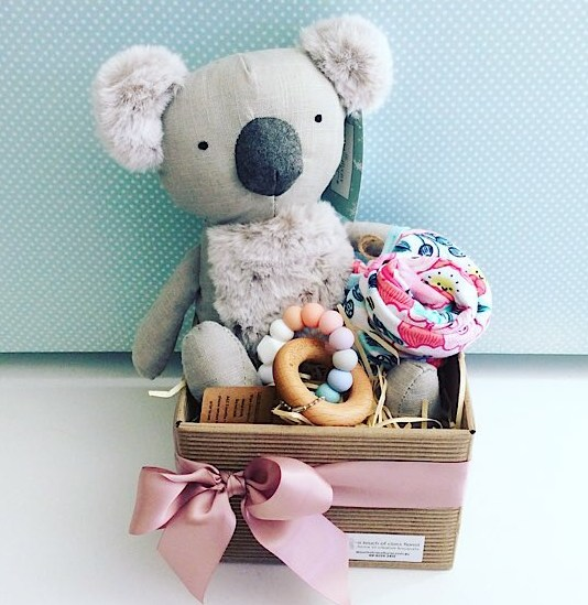 Baby Aussie Bundle in Pink includes Keith the Koala from Nana Huchy, a teething ring from Natre Bubz and an item of baby clothing gift wrapped in a box for you - A Touch of Class Florist Perth
