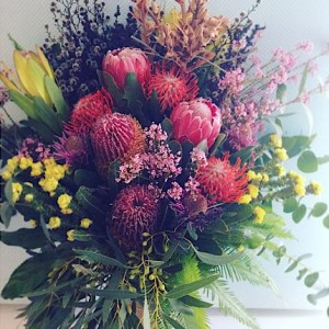 Large Wildflower Inspired Vase Arrangement is a tall glass vase arrangement of seasonal Australian Natives and other blooms with a similar feel - A Touch of Class Florist Perth