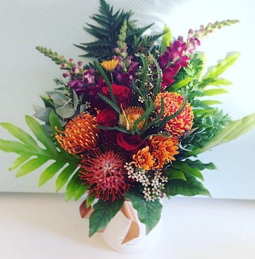 Easy Tiger Arrangement is a ceramic pot arrangment in rich and warm tones - A Touch of Class Florist Perth