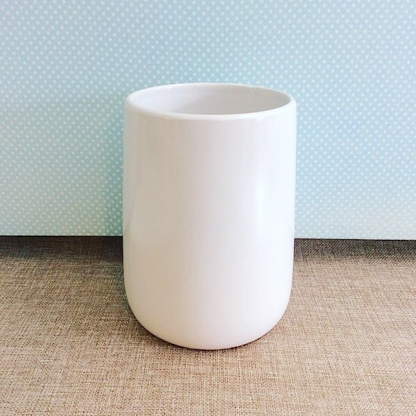 Ceramic Belly Vase is a white ceramic vase approximately 18cm high that is slightly wider at the base - A Touch of Class Florist Perth