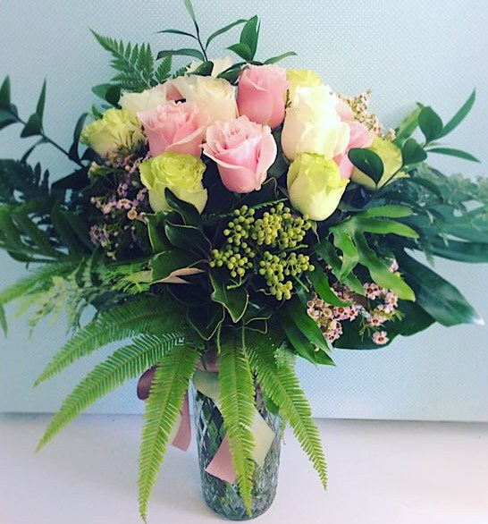 Coloured Rose Vase Deluxe Value shown. Standard value has 12 mixed coloured roses arranged in a glass vase with lush greenery - A Touch of Class Florist Perth