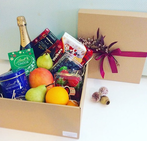 Goodies and Bubbles Christmas Hamper includes sparkling wine, fresh fruit, chocolate and Christmas Sweet treats - A Touch of Class Florist Perth