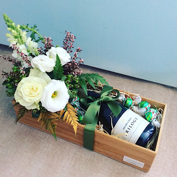 Just For You Christmas Edition includes a small arrangement of fresh flowers, a bottle of sparkling wine and some festive chocolates all wrapped up in a bamboo tray - A Touch of Class Florist