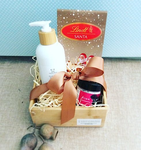 Festive Thoughts Hamper includes some chocolates, a pink clay face mask and some hand and body moisturiser - A touch of Class Florist Perth