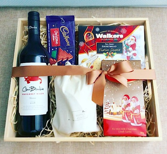 Night Before Christmas Hamper includes a selection of Christmas goodies, a bottle of wine, and a Bear and Find hand poured soy candle - A Touch of Class Florist