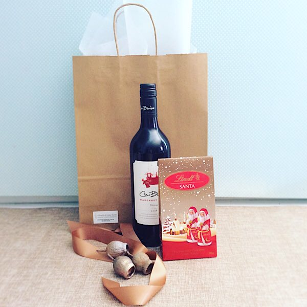 Secret Santa Hamper is for when you just want to send a little Festive Cheer. Includes a bottle of wine and some festive chocolates - A Touch of Class Florist