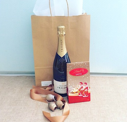 Secret Santa with sparkles includes a bottle of sparkling wine and some festive chocolates - A Touch of Class Florist
