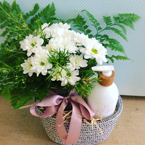 Love you Mum Gift Hamper includes a small jam jar of pastel chrysanthemum and a Salted Bliss Hand cream gift wrapped in a reusable basket - A Touch of Class Florist Perth