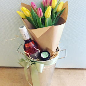 Treats For Mum gift hamper includes a bottle of rose wine, a possum and Blossom Hand salve and a lovely bunch of fresh Tulips all packaged into a tin bucket - A Touch of Class Florist Perth