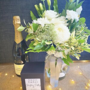 Christmas Peace Gift Selection includes a jam jar of fresh white seasonal florals, a festive themed soy candle form Sweet Ember and a bottle of Australian sparkling wine. A Touch of Class florist Perth
