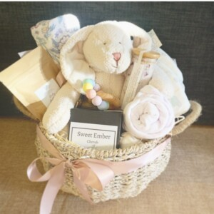 Classic Baby Hamper in Pinks is a hamper with a some gifts for a newborn and some gifts for mum! Gift wrapped and resented in a hamper basket by A Touch of Class Florist Perth.