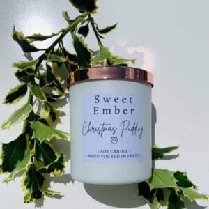 Sweet Ember Soy Candle in Christmas Pudding Scent. Hand poured into a white pot with a rose gold lid. A Touch of class Florist Perth
