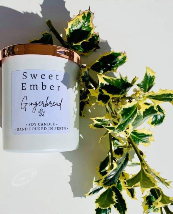 Sweet Ember Soy Candle in Gingerbread scent. In a white pot with a rose gold lid. A Touch of Class Florist Perth