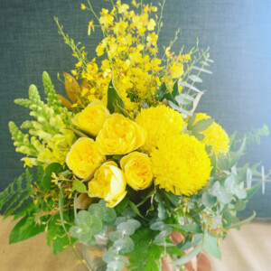 Seasonal Fishbowl in Yellow by A Touch of Class florist is a vibrant arrangement of seasonal blooms in yellow tones. Arranged into a glass fishbowl vase. By A Touch of Class Florist Perth