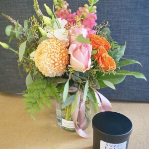Gift For You Black by A Touch of Class Florist Perth includes as seasonal jam jar of fresh flowers and a Sweet Ember candle, scent will vary, in a black jar with a black lid.