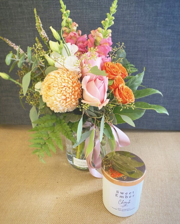 Gift For You White and Rose Gold by A Touch of Class Florist Perth includes a seasonal jam jar of fresh flowers and a Sweet Ember candle, scent will vary, in a white jar with Rose gold lid.