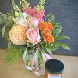 Gift for You Rose Gold and Black by A Touch of Class Florist Perth includes a seasonal jam jar of fresh flowers and a Sweet Ember candle, scent will vary, in a Rose gold jar with a black lid.